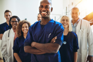 healthcare professionals standing together smiling